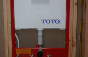 Rough in of wall mounted Toto toilet. The tank is in the wall for a clean and space saving installation.